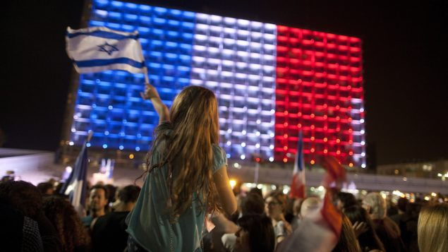 People gather to show solidarity with the victims of the Paris attacks in Tel Aviv's Rabin Square. Getty Images