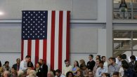 A girl, top right, sits above a campaign town hall meeting with Democratic presidential candidate Hillary Clinton. RNS