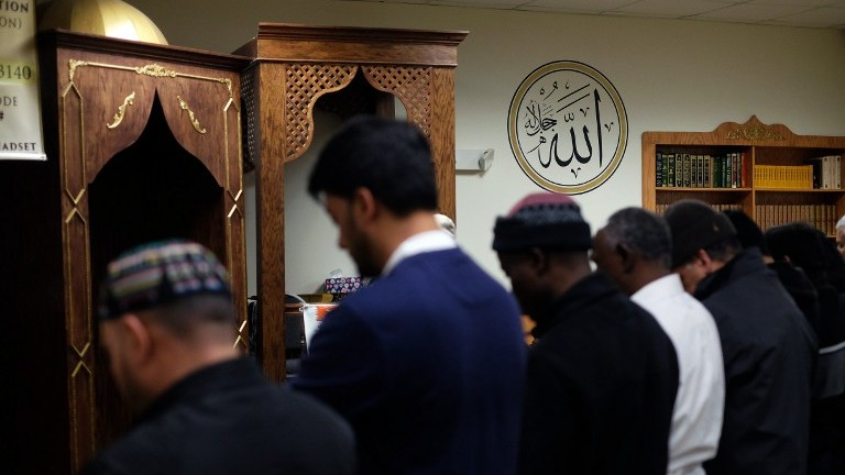 Illustrative image of American Muslim men praying at a mosque in Jersey City, New Jersey, on December 7, 2015. (AFP PHOTO/JEWEL SAMAD)