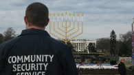 A Community Security Service agent stands guard at a menorah lighting in Washington, D.C. Courtesy of CSS