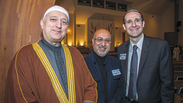 Rabbi Noah Fabricant, right, and Imam Moutaz Charaf, left, with a member of Imam Charaf's mosque. (Antony Morales)