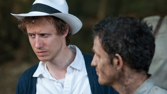 "Director László Nemes and Géza Röhrig on the set of ""Son of Saul."" Photo by Ildi Hermann, Courtesy of Sony Pictures Classics"