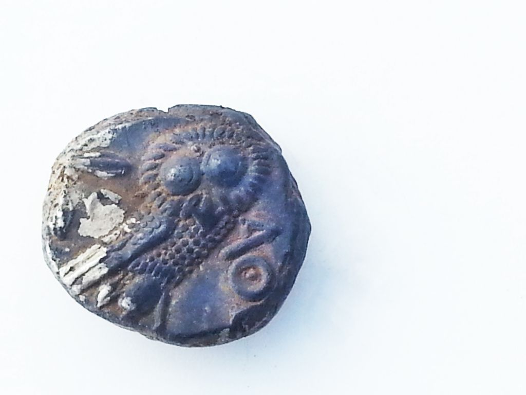 Reverse of a 4th century silver coin with the owl of Athena found in a 2,700-year-old farmhouse near Rosh Ha'ayin. (Israel Antiquities Authority)