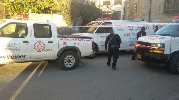 Ambulances arrive at the scene of a stabbing attack near the Tomb of the Patriarchs in Hebron on December 7, 2015. (Magen David Adom)