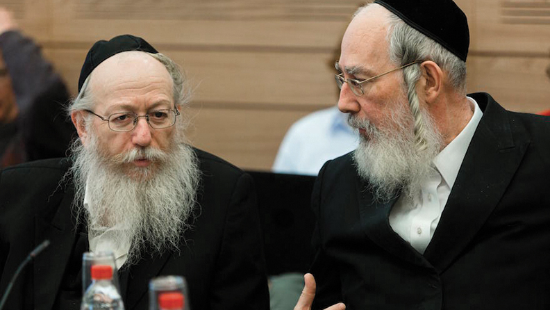Charedi Orthodox lawmaker Yisrael Eichler, right, at a finance committee meeting at the Knesset on December 25, 2013. (Flash90)