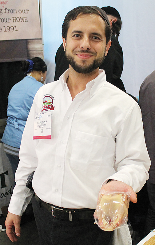 Pelle Poultry's Eliezer Franklin holds squab — aka pigeon — at KosherFest in Secaucus in November.