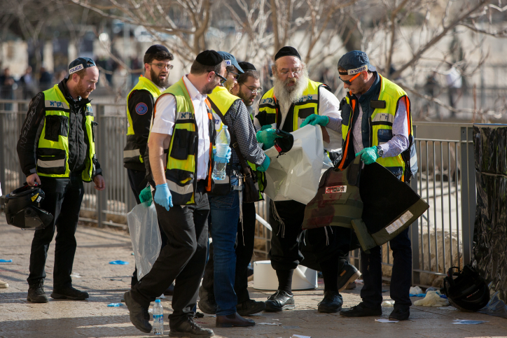 Paramedics at the scene where two Palestinian stabbed three Israelis at the Old City's Jaffa Gate in Jerusalem on December 23, 2015. (Yonatan Sindel/Flash90)