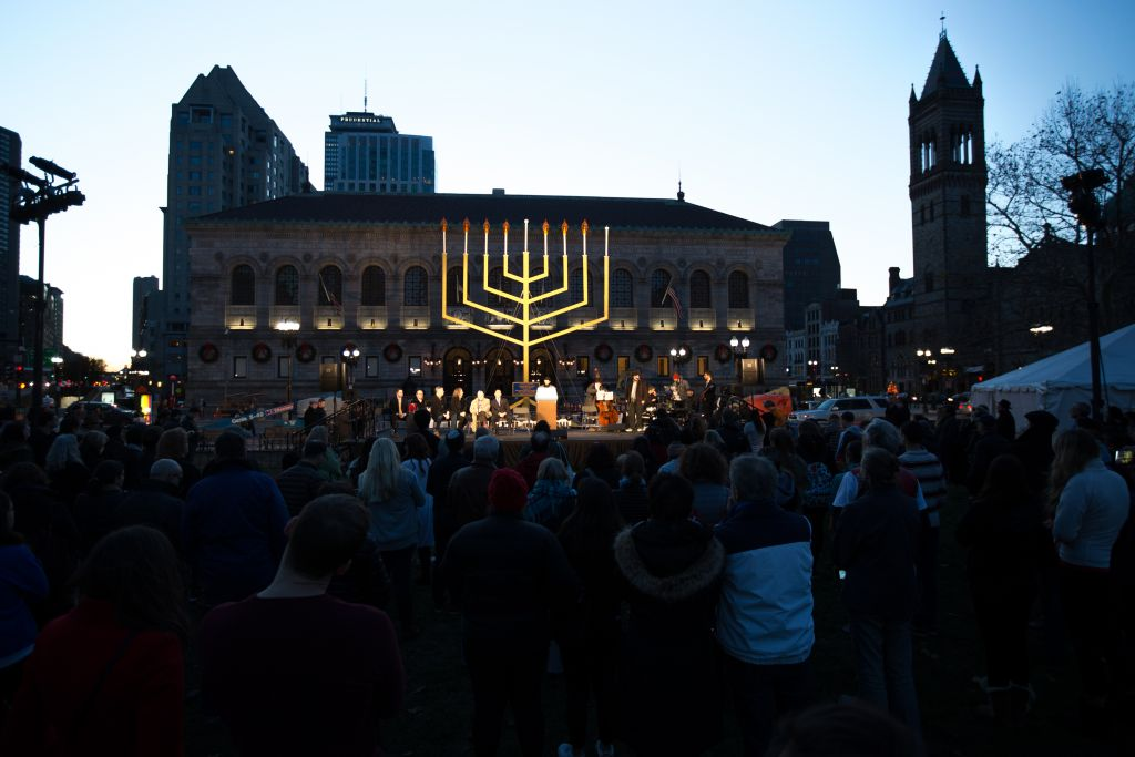 Massachusetts governor Charlie Baker and other leaders participate in the Chabad-led Hanukkah candle-lighting ceremony in Boston's Copley Square, on December 6, 2015 (Elan Kawesch/The Times of Israel)