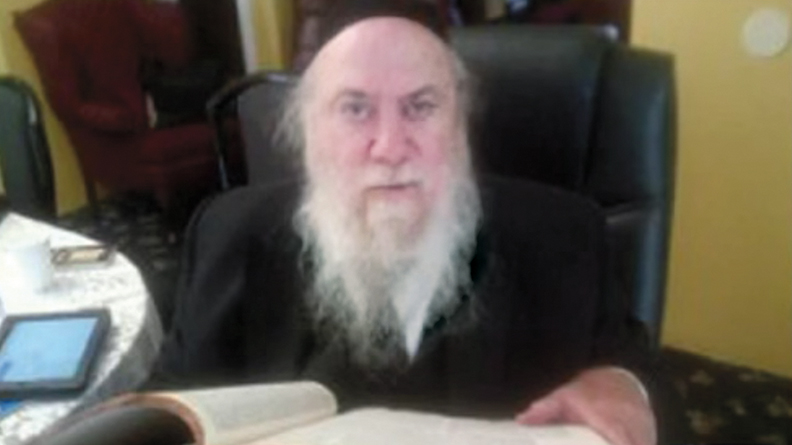 Mendel Epstein, one of the rabbis sentenced to prison this year after a 2013 FBI sting. (Screenshot from YouTube)