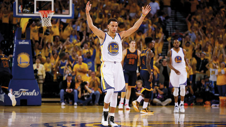 Stephen Curry of the Golden State Warriors celebrates during Game 2 of the 2015 NBA Finals at Oracle Arena in Oakland on June 7. (Ezra Shaw/Getty Images)