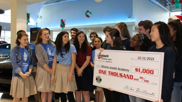 AJA Students Win, Donate $1,000 1