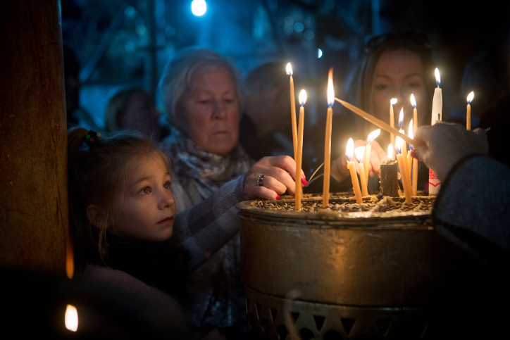 Candle lighting at the Church of Nativity in Bethlehem on December 23, 2015, the day before Christmas Eve. Photo by Miriam Alster/FLASh90