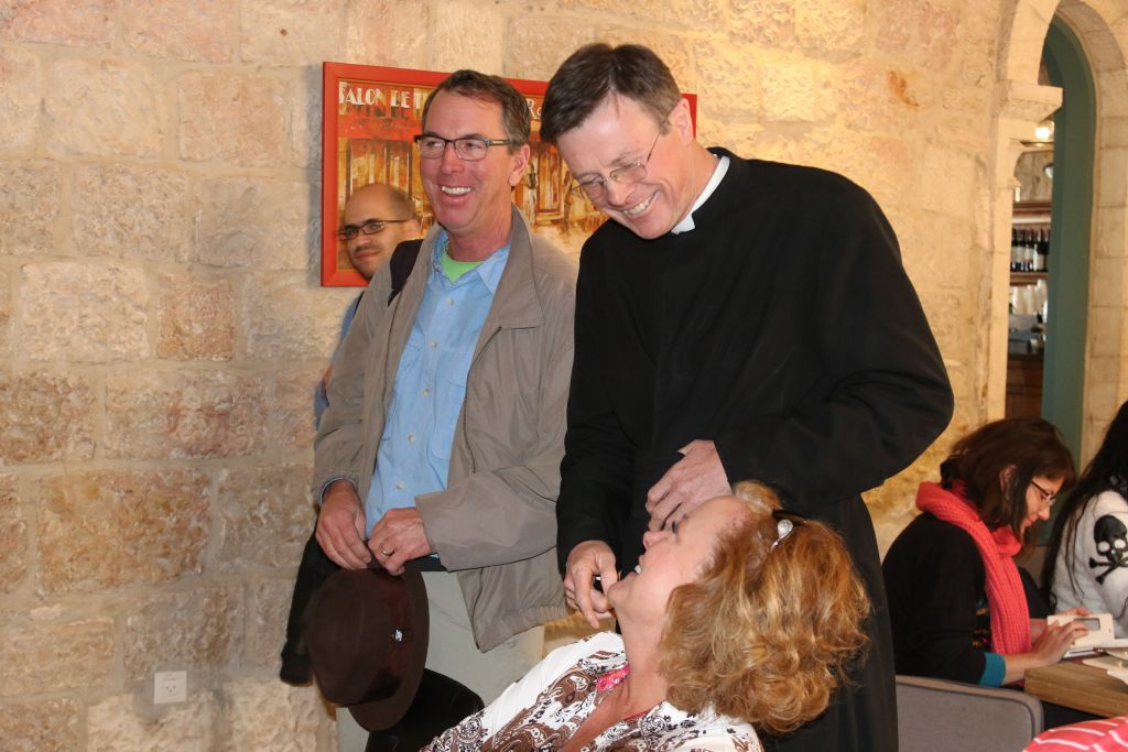 Father Eamon Kelly greets guests at Notre Dame (Shmuel Bar-Am)