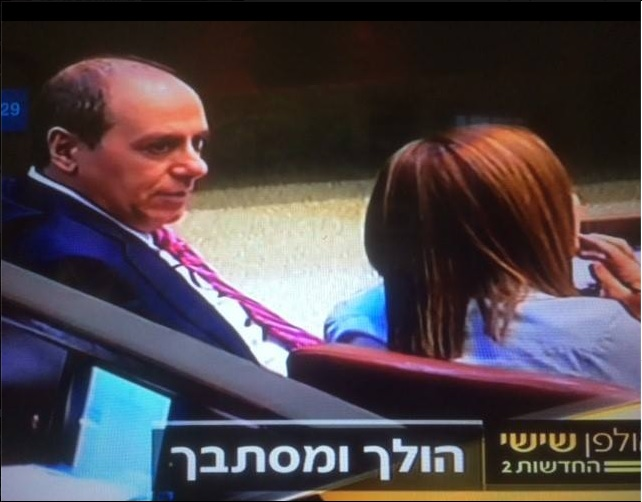 Interior Minister Silvan Shalom speaks to Zionist Union MK Shelly Yachimovich in the Knesset plenum. The picture was shared by Yachimovich in a Facebook post in which she called on the minister to suspend himself, posted on December 19 2015. (Screen capture Facebook)