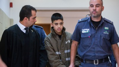 Attorney Tareq Barghout (L) is seen with his client, 13-year-old accused terrorist Ahmed Manasra, at Jerusalem District Court on October 25, 2015. (Yonatan Sindel/Flash90)