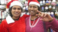 Shama Senanyakgi, left, and her friend Dharshani Dias, foreign caregivers from Sri Lanka, go Christmas shopping. JTA