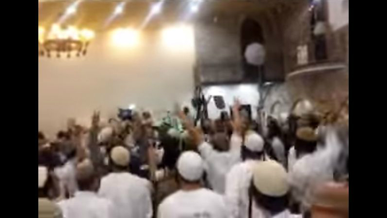 Screenshot of a video showing extremist Israeli Jewish wedding-goers celebrating the killings of the Dawabsha family. (screen capture: Channel 10)