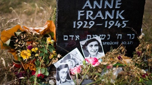 A memorial stone for Anne Frank and her sister Margot on the grounds of the former Prisoner of War (POW) and concentration camps Bergen-Belsen in Bergen, north of Hanover, central Germany, on June 21, 2015. (AFP / NIGEL TREBLIN)