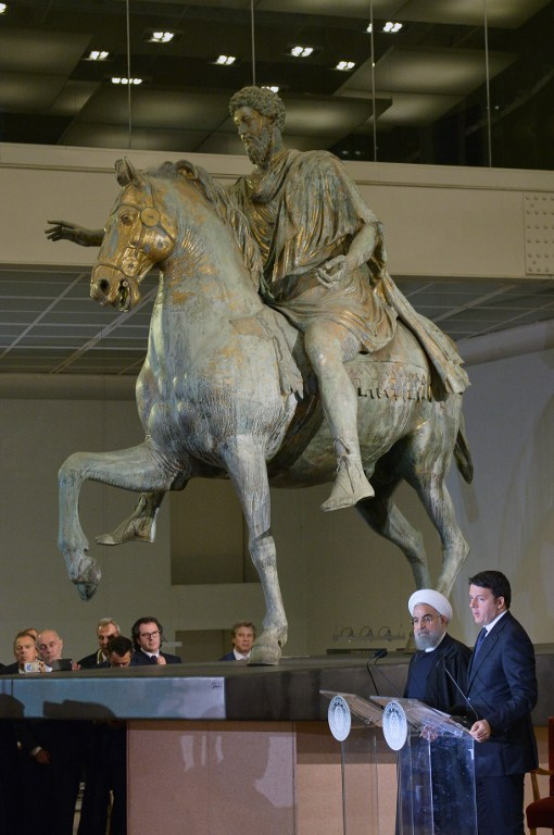 Iranian President Hassan Rouhani (2ndR) and Italian Prime Minister Matteo Renzi (R) hold a press conference at the Capitol Hill in Rome, next to the equestrian statue of Marcus Aurelius, on January 25, 2016. (Tiziana Fabi/AFP)