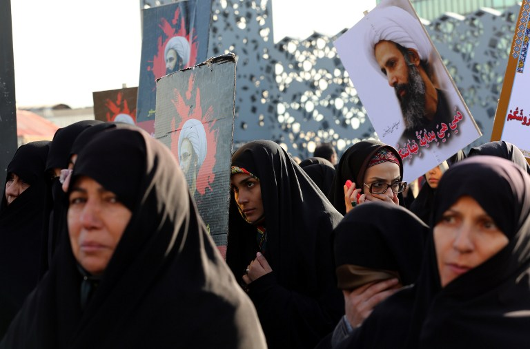 Iranian women gather during a demonstration against the execution of prominent Shiite Muslim cleric Nimr al-Nimr by Saudi authorities, at Imam Hossein Square in the capital Tehran, January 4, 2016. (AFP/ATTA KENARE)