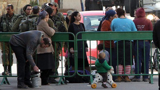 Jewish settlers gather their belongings last week after being evacuated by Israeli security forces from two homes.