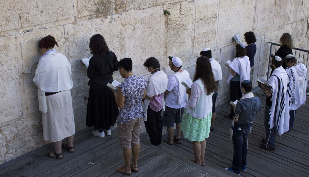 Conservative Jews pray at the section prepared for prayer for the Women of the Wall at Robinson's Arch in Jerusalem's Old City on July 30, 2014. (Robert Swift/Flash90)