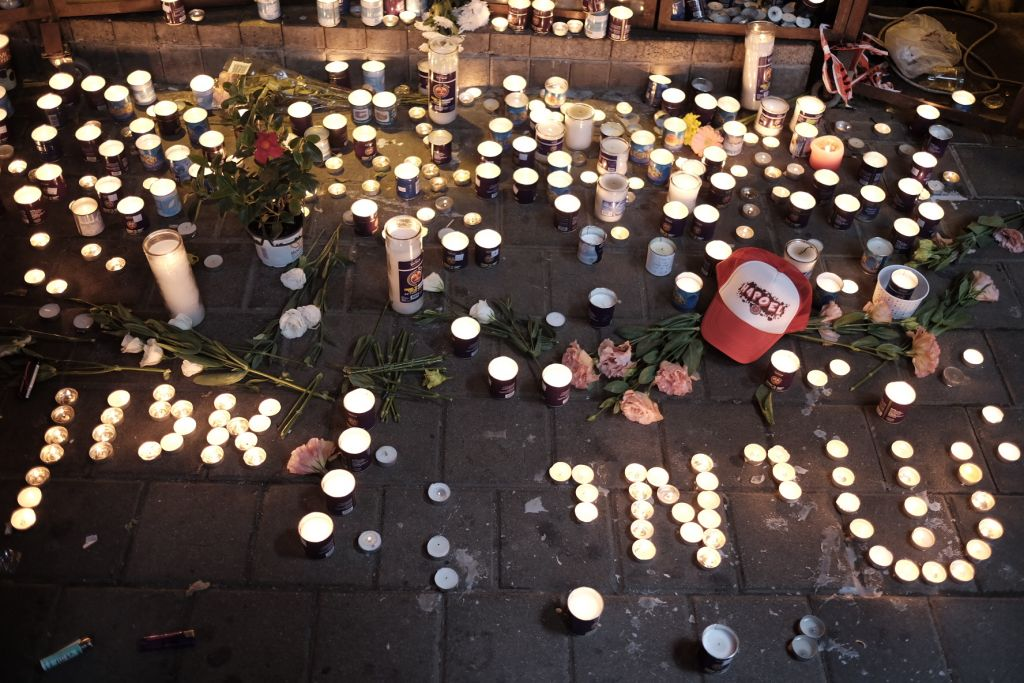 File: Memorial candles spell out the names of victims Alon Bakal and Shimon Ruimi, outside the Simta pub on Dizengoff Street in central Tel Aviv, on January 02. (Tomer Neuberg/Flash90)