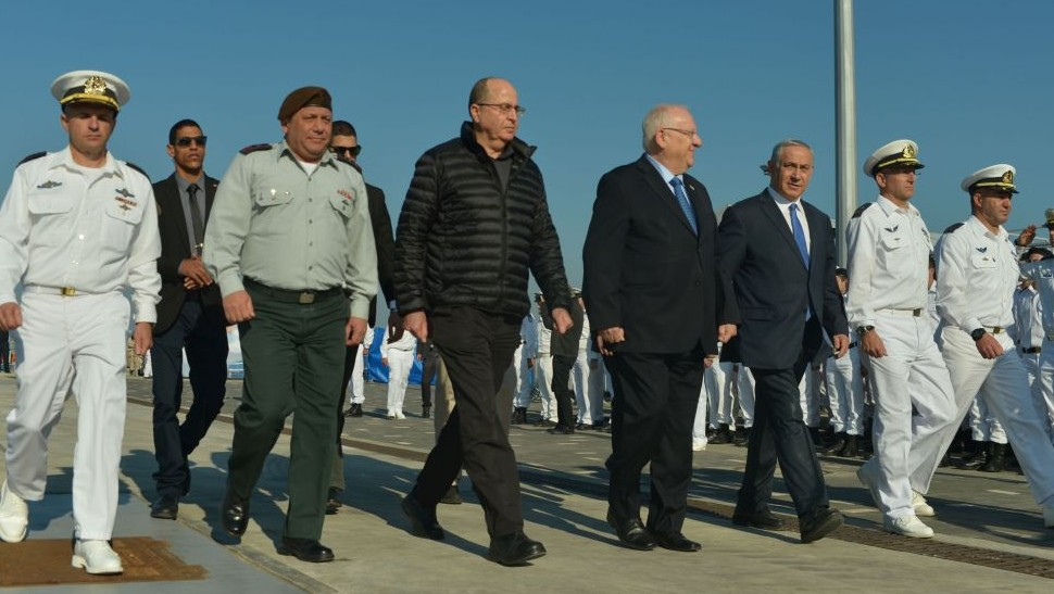 IDF Chief of Staff Gadi Eisenkot, then defense minister Moshe Ya'alon, President Reuven Rivlin and Prime Minister Benjamin Netanyahu at a welcoming ceremony for the new submarine 'Rahav' at the Israeli navy base in Haifa, on January 12, 2016. (Kobi Gideon/GPO)