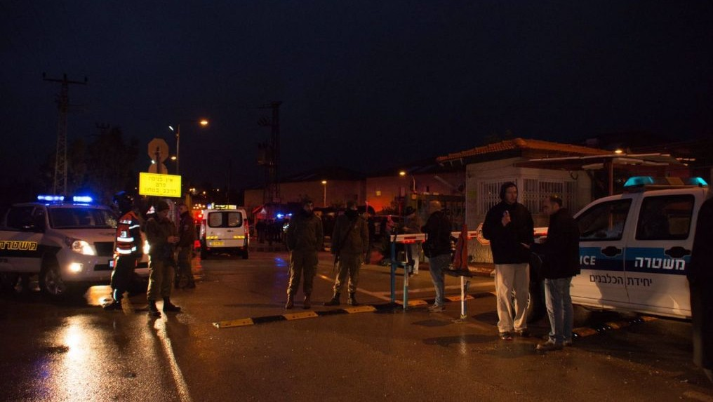 Police officers and emergency service employees at the scene of a terror attack in which two people were wounded by two Palestinian stabbers, in the West Bank settlement of Beit Horon on Monday, January 25 2016 .(Israel Police)