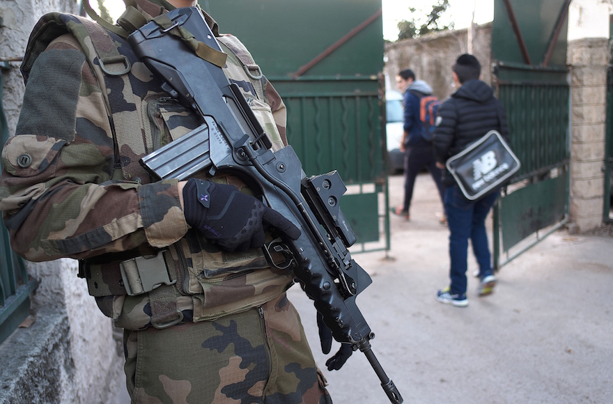 An armed French soldier securing the access to the La Source Jewish school in Marseille, southern France a day after a teenager, armed with a machete and a knife, wounded a teacher slightly before being stopped and arrested, January 12, 2016. (Boris Horvat/AFP/Getty Images, via JTA)