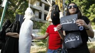 In this Thursday, April 1, 2010 file photo, activists from a civil organization reenact an execution scene in front of the Saudi Arabia Embassy in Beirut, Lebanon, as they protest a possible beheading of a Lebanese man accused of witchcraft in Saudi Arabia. (AP/Bilal Hussein, File)