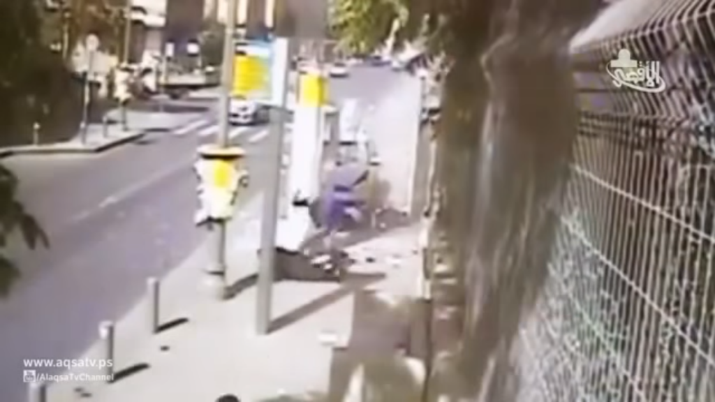 "Footage of Alaa Abu Jamal stabbing passers-by in a Jerusalem terror attack on October 15, 2014. The attack is praised in the song ""Lovers of Stabbing"" while the clip plays in the background. (screen capture: YouTube)"