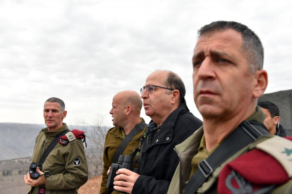 Deputy Chief of Staff Yair Golan speaks with Defense Minister Moshe Ya'alon (second from the right) and head of the Northern Command Aviv Kochavi (right) during a visit to Israel's northern border following a Hezbollah attack the day before on January 5, 2016. (Ariel Hermoni/Defense Ministry)
