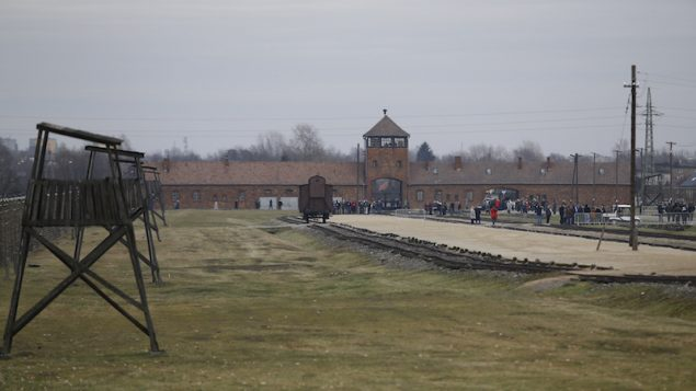 Visitors gather on the grounds of the former Nazi German concentration and extermination camp Auschwitz-Birkenau. RNS