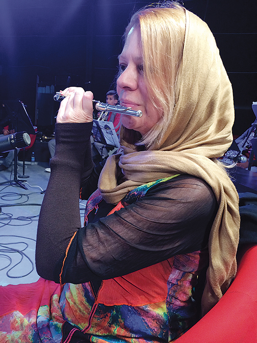 Ms. Perrin playing piccolo at a recording session for the Afghanistan National Children's Anthem sponsored by Save the Children. It was interrupted by an earthquake.