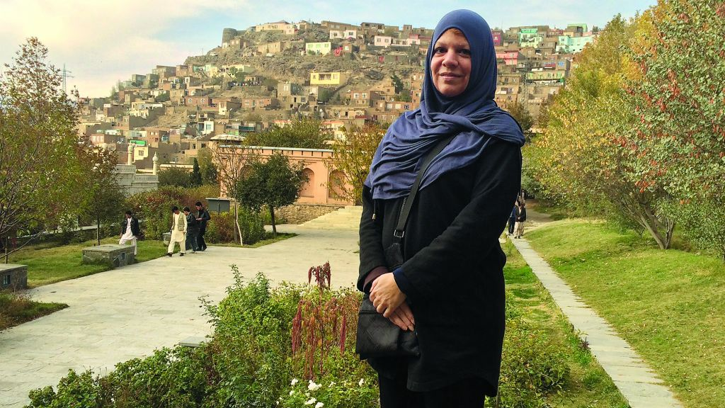 """At the Gardens of Babar — """"one of the most beautiful spots in Kabul,"""" Ms. Perrin says — a strand of hair escapes her scarf."""