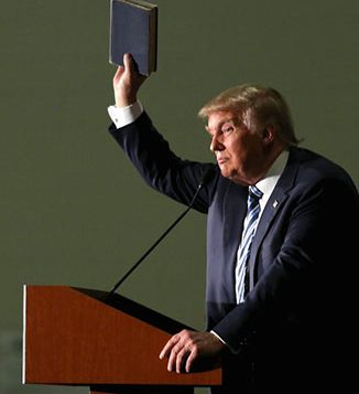 Republican presidential candidate Donald Trump holds up a copy of the Bible he said his mother gave him as a youth. RNS