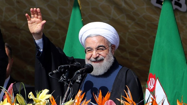 Iranian President Hassan Rouhani waves to the crowd during a rally in Tehran's Azadi Square (Freedom Square) to mark the 37th anniversary of the Islamic revolution on February 11, 2016. (Atta Kenare/AFP)