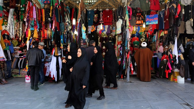 Illustrative: Iranian women shop near the Hazrat Fatimah Ma'sumeh mausoleum in the holy city of Qom, 130 kilometers south of Tehran, on February 24, 2016. (AFP / ATTA KENARE)