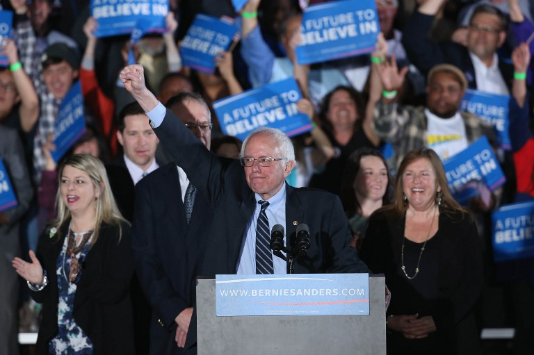 Democratic presidential candidate Bernie Sanders and his wife Jane O'Meara (R) greets supporters after winning the New Hampshire Democratic Primary February 9, 2016 in Concord, New Hampshire. (Win McNamee/Getty Images/AFP)