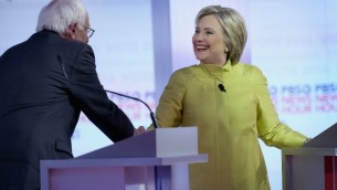 Democratic presidential candidates Senator Bernie Sanders (L) and Hillary Clinton participate in the PBS NewsHour Democratic presidential candidate debate at the University of Wisconsin-Milwaukee on February 11, 2016 in Milwaukee, Wisconsin. (Win McNamee/Getty Images/AFP)