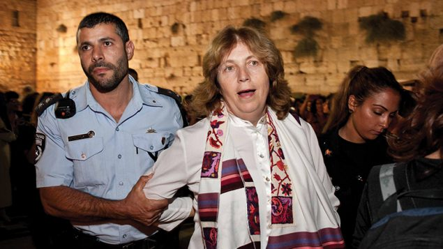 Israeli police arresting Anat Hoffman in 2012 after she said the Shema prayer at the Kotel. Women of the Wall