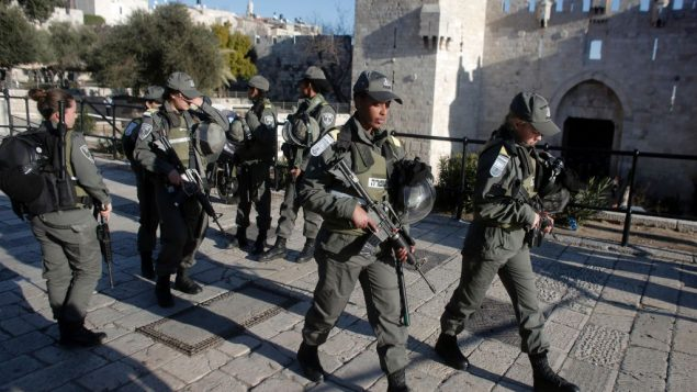 Israeli border police-women patrol a street following an attack by three Palestinian assailants at Damascus Gate. Getty Images