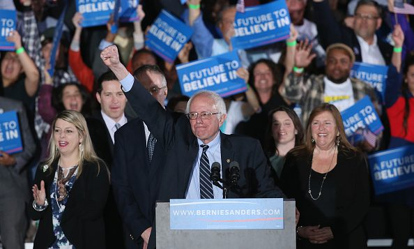 Bernie Sanders, with his wife, Jane O'Meara, at right, greets supporters after winning the New Hampshire primary. Getty Images