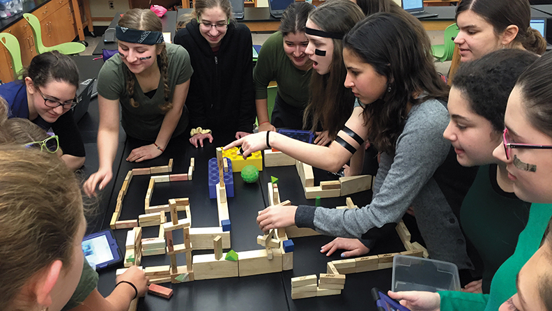 Eighth-graders at Yeshivat Noam guide a Sphero through a maze.