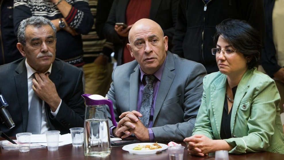 Joint (Arab) List members Jamal Zahalka (left), Basel Ghattas (center) and Hanin Zoabi (right) at the weekly Joint (Arab) List meeting at the Knesset, on February 8, 2016. On January 2, the trio met with the families of Palestinian terrorists, prompting a political outcry. (Yonatan Sindel/Flash90)