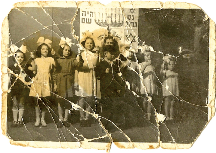 Genyusha, at far right, somewhere in eastern Europe during Chanukah.