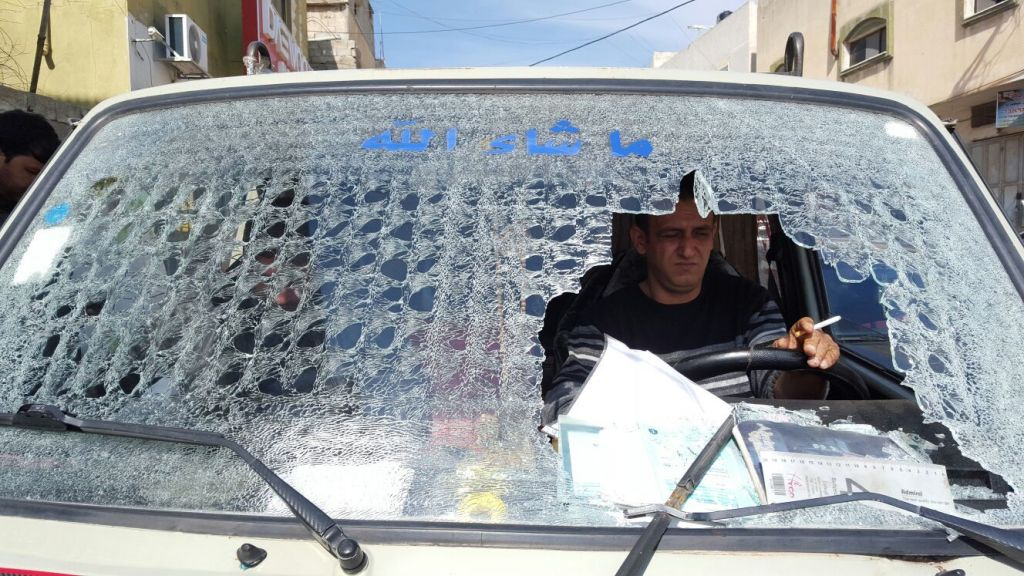 The windshield of a Palestinian vehicle, which was reportedly destroyed by an Israeli settler with an axe outside of the Karnei Shomron settlement on February 10, 2016. (Zachria Sadah/Rabbis for Human Rights)