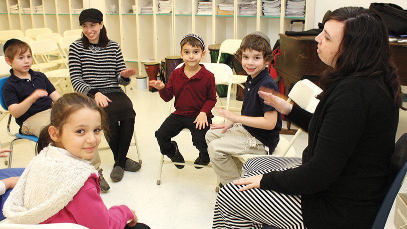 Music teacher Erika Svolos, right, with a group of students.