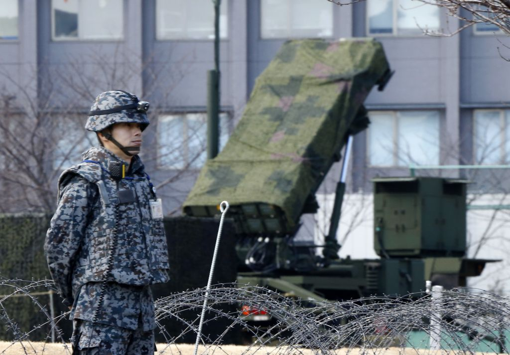 A Japan Self-Defense Force member stands by a PAC-3 Patriot missile unit deployed for North Korea's rocket launch at the Defense Ministry in Tokyo, Sunday, January 31, 2016. (AP Photo/Shizuo Kambayashi)